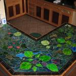 Custom cut and painted tile used for the top of our bar, in the house we built.